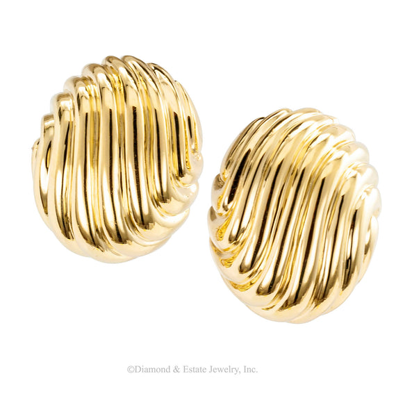 Button style fluted yellow gold omega clip back earrings circa 1970.