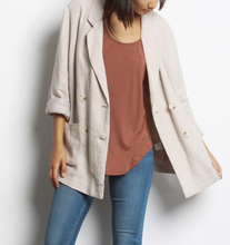 double breasted linen blazer with rolled sleeves worn open