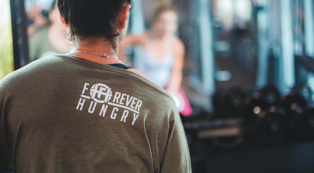 Athletic coach and trainer wearing Forever Hungry logo fitness apparel.