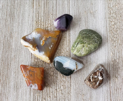 Healing crystals with jasper on a wood surface