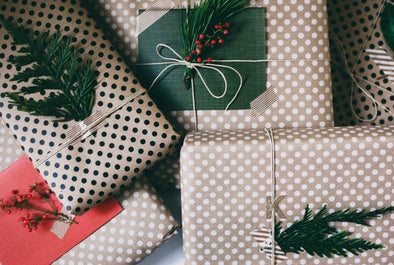 christmas gifts in polka dot brown paper