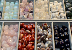 Gems and healing crystals sorted in rows