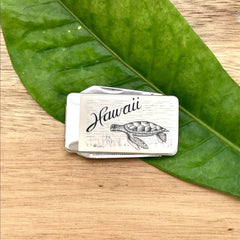 Scrimshaw Style Money Clip with Hawaii and a turtle on the cover