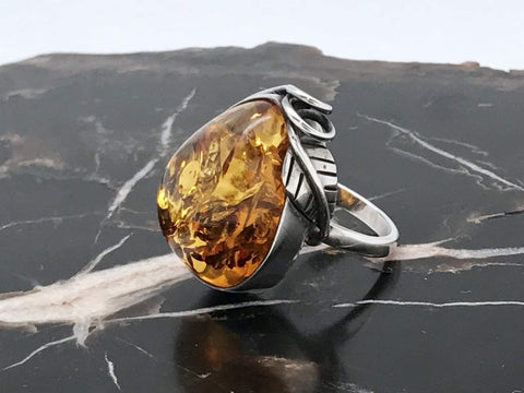Baltic Amber Silver Ring on marble table
