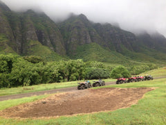 ATVs on path with mountains in background