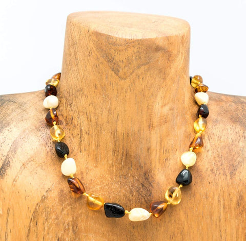 """13"""" Baltic Amber Baby Bead Necklace - BANL02 on wooden necklace display"""