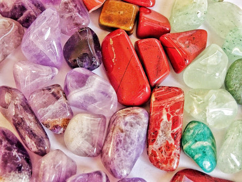 purple, red, and green tone gemstones