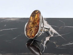 Baltic Amber Ring on black marble table