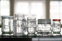 Assorted mason jars in front of window
