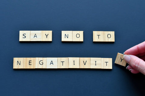 """""""Say no to negativity"""" written on wooden cubes"""