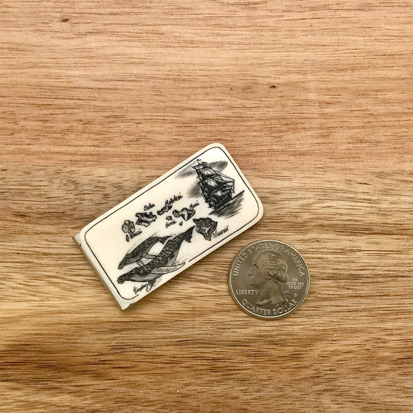 Scrimshaw Style Wide Money Clip featuring humpback whale, Hawaiian islands and ship detail designed by artist Linda Layden with US quarter for size comparison