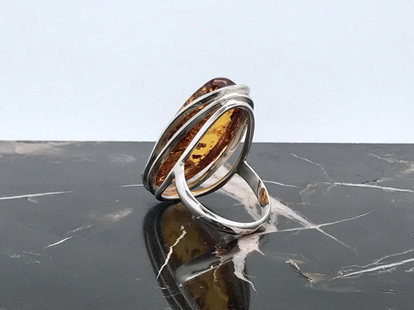 Rich honey Baltic Amber piece set in 925 sterling silver. The ring is a size of 9 1/2.  - BAR001