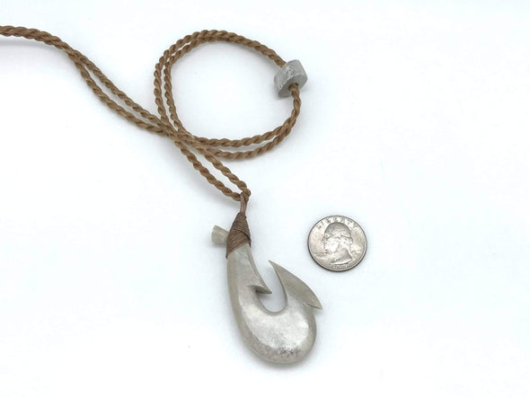 "2 3/8"" Maui Fish Hook hand carved from moose antler by artist Ray Peters. Shown with US quarter for size comparison."