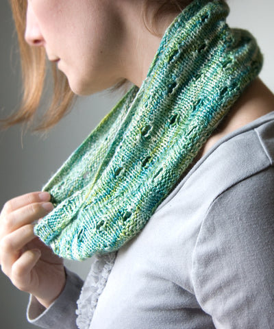 Knitted cowl in silk with eyelets
