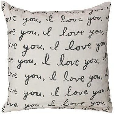Sugrboo Designs cream color stonewashed linen square pillow, printed with multiple lines across front in black cursive font that repeat