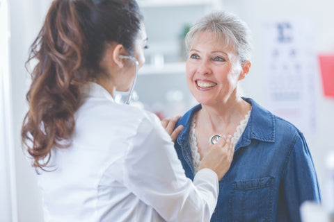 older woman with doctor