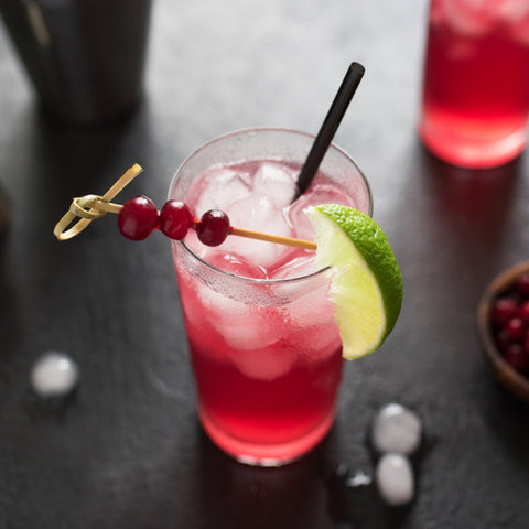 Cranberry Herbal Cocktail with a Lime Wedge