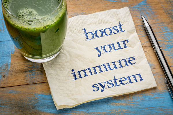 Boot Your Immune System typed on a napkin with healthy drink
