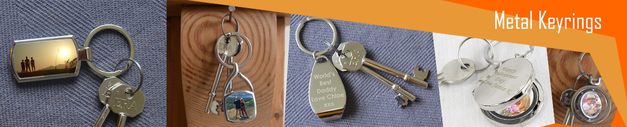 A collection of metal personalised keyrings, including a rectangular metal keyring, a square metal keyring, an engraved bottle opener keyring, a personalised locket keyring with a photo inside and a spinning circular keyring with a photo on either side.
