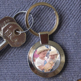 Personalised metal circular keyring with a family photo in the centre