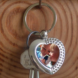 A Personalised metal heart keyring with a family photo in the centre