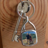 A personalised metal keyring in a square shape featuring a holiday photo
