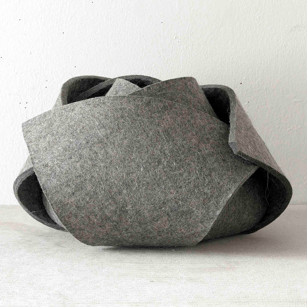 Rosebud Felt Bowl by Domestic Aesthetic. This single piece of industrial felt transforms into any number of shapes with the help of magnetic connections but we prefer it as a lovely rosebud.