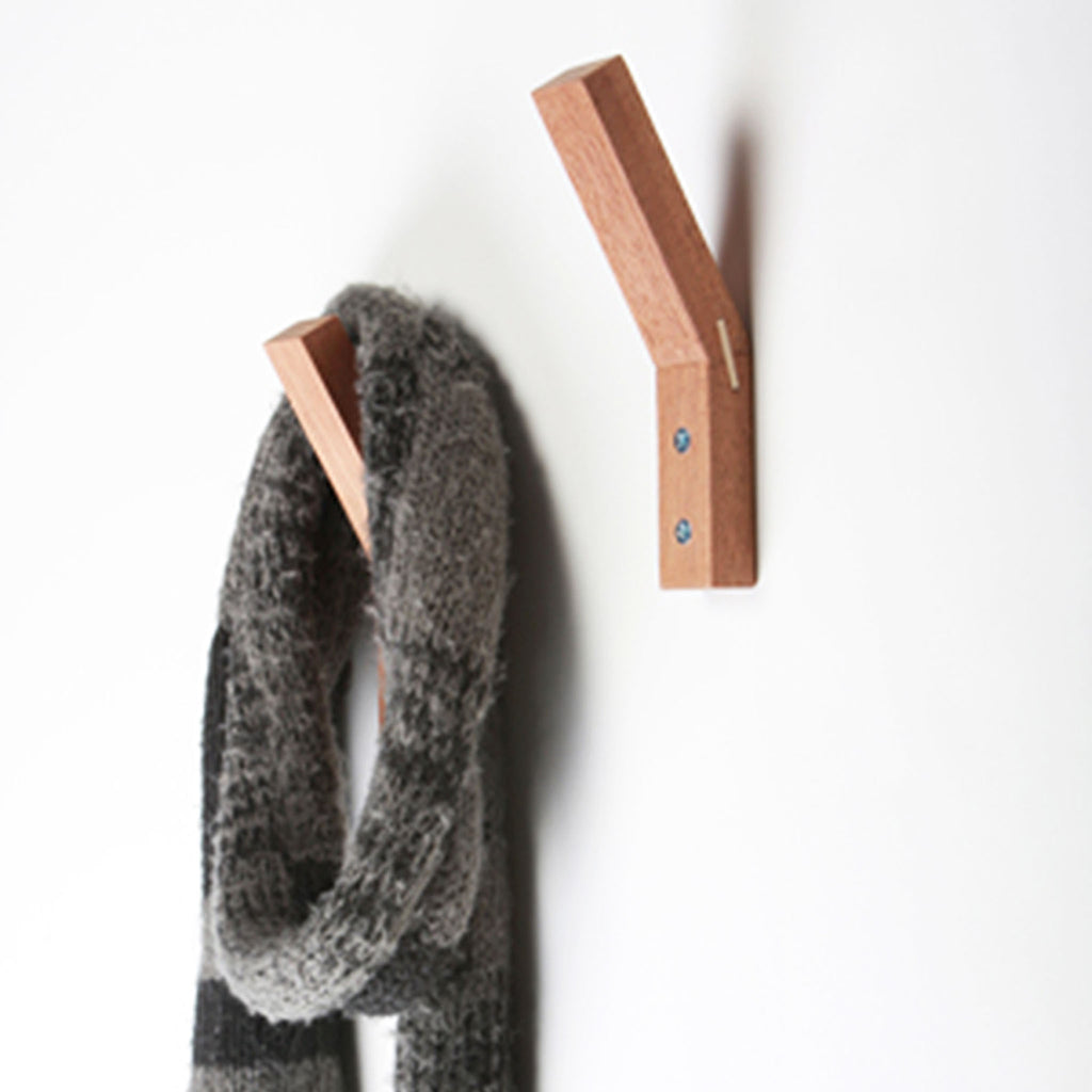 Hang Out Hooks by DavidZachary. Handmade in Brooklyn, these coat hooks are made from reclaimed, post-manufacturing off-cut wood. Sold in sets of two hooks.