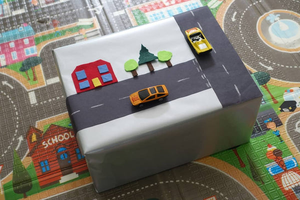 Baby gift wrapped with a road