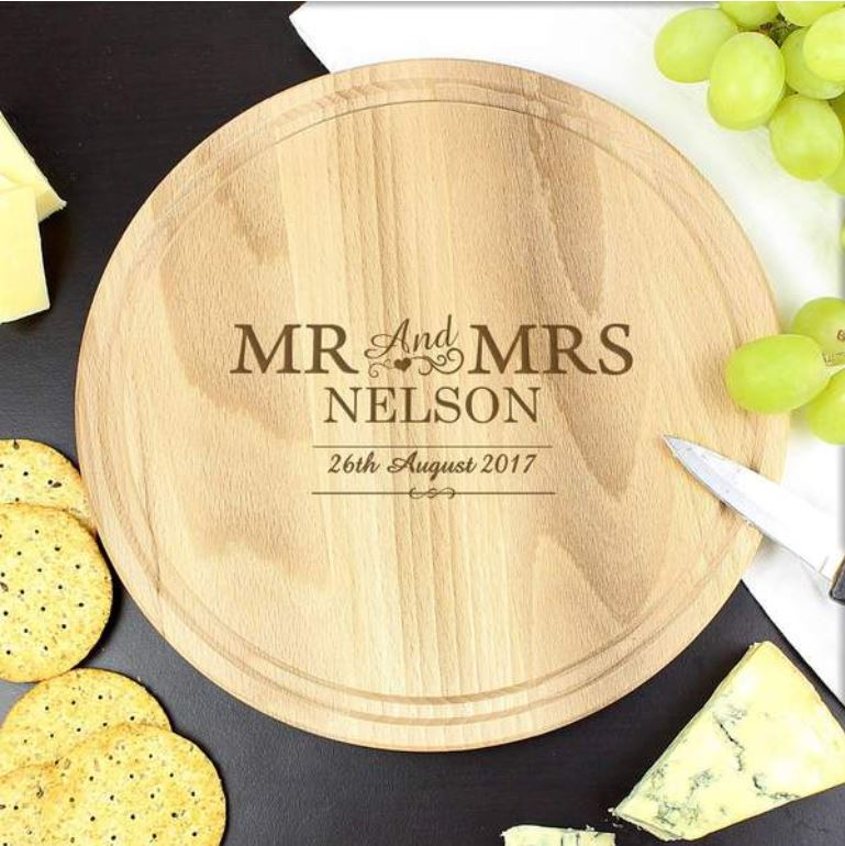 A personalised circular wooden chopping board