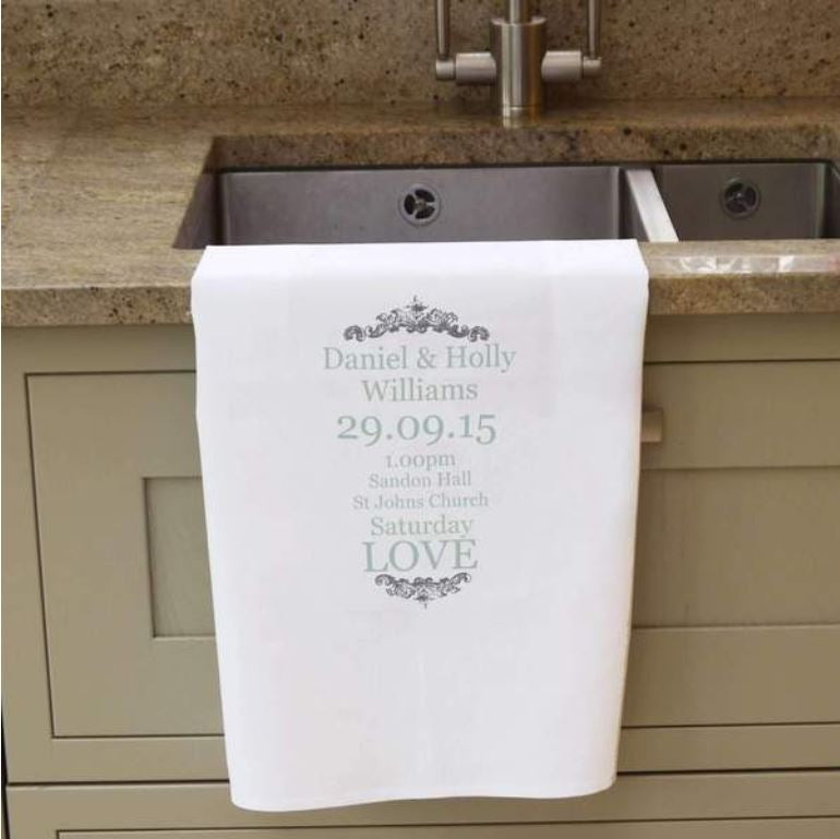 A personalised romantic tea towel. The personalised message is printed in grey and the tea towel is white.