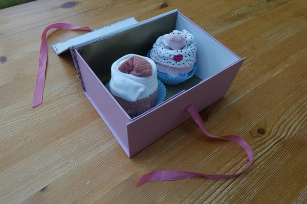 Baby clothes wrapped as cupcakes