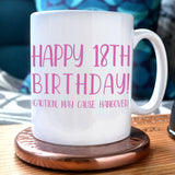 "A personalised white mug with pink text reading ""happy 18th birthday (caution may cause hangover)"""