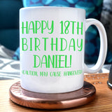 "A personalised mug with text in green reading ""happy 18th birthday Daniel (caution may cause hangover)"""