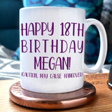 "A personalised birthday mug with the message ""happy 18th birthday Megan (caution may cause hangover)"""