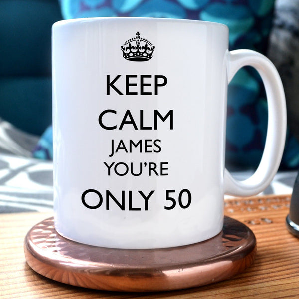 "A personalised white mug with the message ""keep calm james you're only 50"" printed on it in black"
