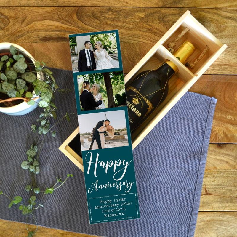 "A personalised wine box with the words ""Happy Anniversary"" printed on it with 3 personal photos."