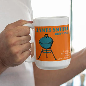 A personalised large father's day mug with a BBQ icon on an orange background