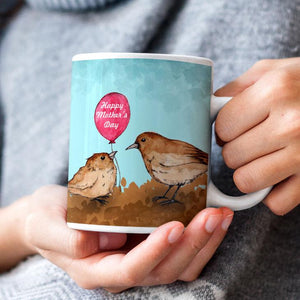 "A personalised blue mug with 2 little brown birds on and a ""Happy Mother's Day"" Message"