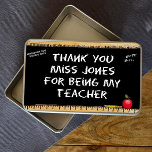 "A personalised metal tin with a chalkboard design printed on the top. The chalkboard has a message printed on it which reads ""thank you Miss Jones for being my teacher"""