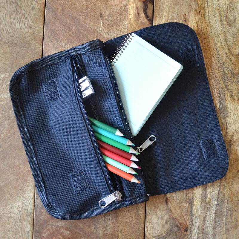 The inside of a personalised black pencil case showing the 2 zip pockets