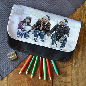 A personalised black fabric pencil case with a family photo printed on it