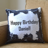 "A black sequin reveal cushion showing the message ""Happy Birthday Daniel"""