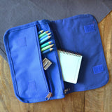 The inside of the blue pencil case showing the 2 zip pockets