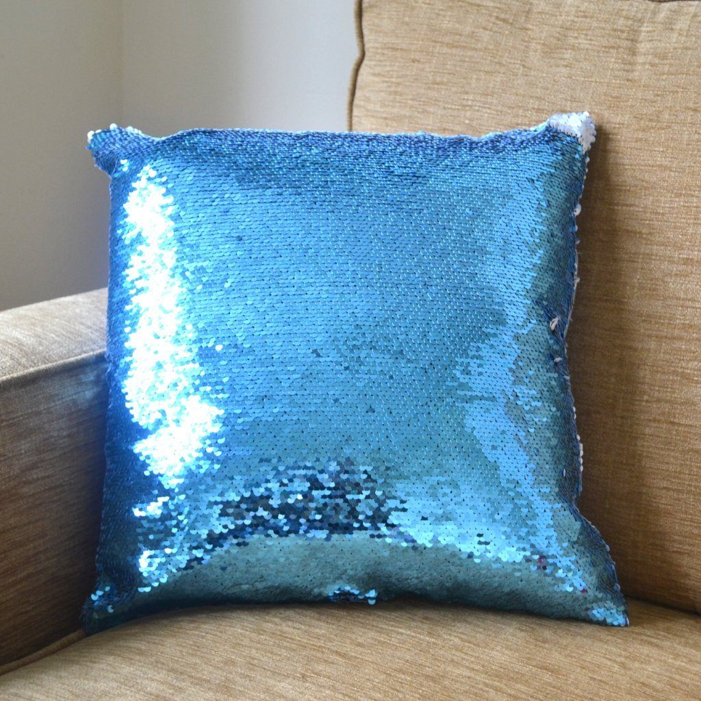 A blue sequin secret message cushion with its message hidden