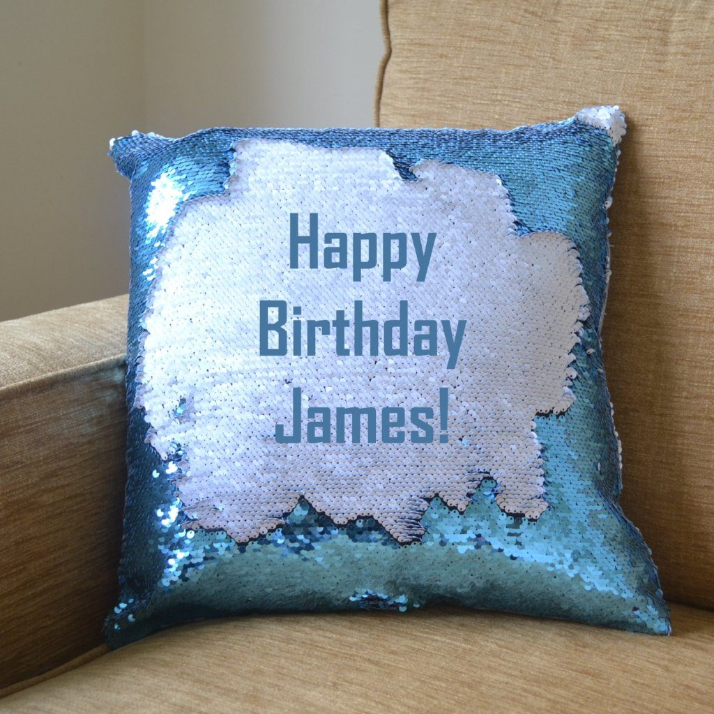 "A blue sequin reveal cushion with its message on show, the message reads ""Happy Birthday James"""