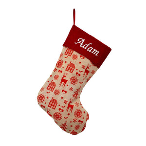 "A personalised red and cream Christmas stocking. The top of the stocking is red and embroidered with the name ""Adam"" in white lettering. The rest of the stocking is cream with a red pattern which includes Christmas trees, snowflakes, houses and reindeer."