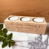 A solid wood personalised memorial candle holder with space for 3 tealights.