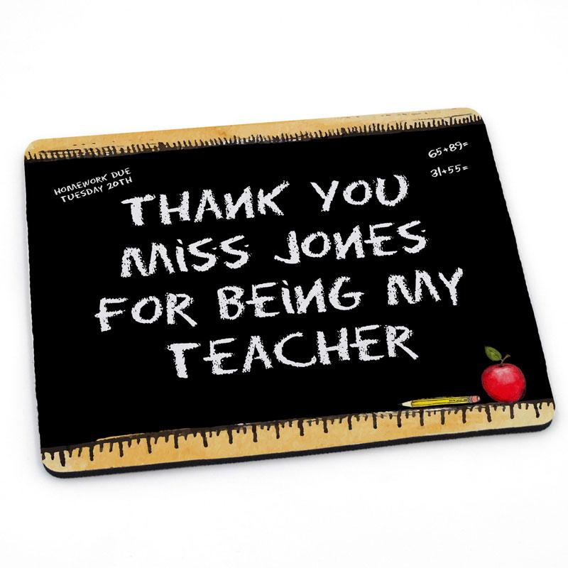 "A personalised chalk board mouse mat with the words ""Thank you Miss Jones for being my teacher"" printed on it."