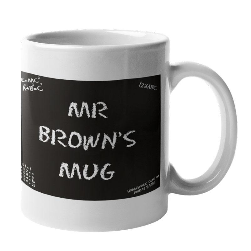 "A personalised teacher mug with a black chalk board design and the words ""Mr Brown's Mug"" in white lettering"